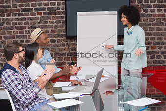 Young business team clapping hands in meeting