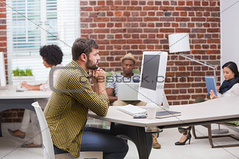 Casual young man using computer