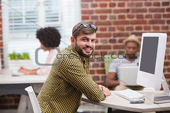 Portrait of casual young man using computer