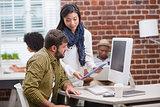 Creative people looking at digital tablet