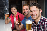 Young men drinking beer together