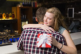 Young couple hugging with a gift