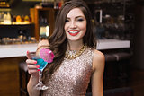 Pretty brunette holding a cocktail