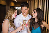 Attractive friends toasting with champagne