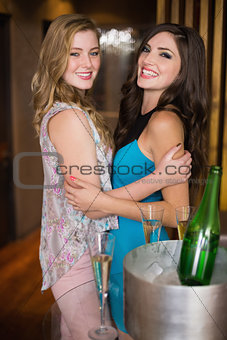 Attractive friends hugging and smiling