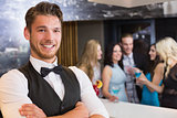 Handsome barman smiling at camera