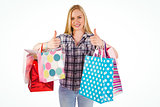 Pretty young blonde holding shopping bags