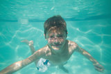 Cute kid posing underwater in pool