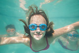 Cute kids posing underwater in pool