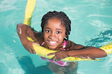 Cute little girl swimming in the pool