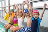Cute swimming class smiling poolside