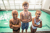 Cute swimming class smiling with medals