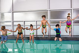 Cute swimming class jumping in the pool
