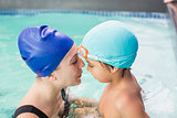 Happy mother and son in the swimming pool
