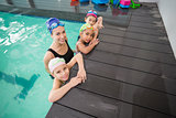 Cute swimming class and coach smiling