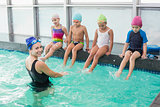 Cute swimming class watching the coach