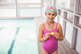 Cute little girl showing her swimming medal