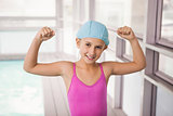 Cute little girl flexing her arms