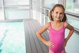 Cute little girl standing poolside