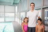 Swimming coach with his students