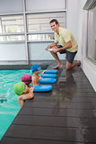 Cute swimming class listening to coach