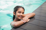 Cute little girl smiling in the pool