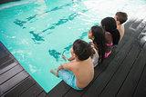 Cute little kids sitting poolside