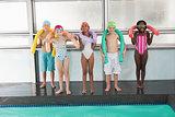 Cute little kids standing poolside with foam rollers