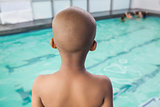 Cute little boy standing at the pool
