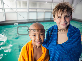 Little boys smiling by the pool