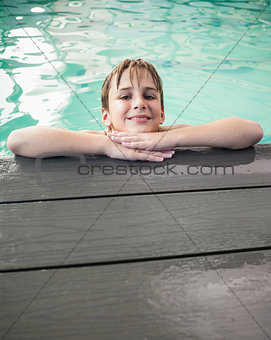 Little boy smiling in the pool