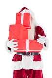 Santa covers his face with presents