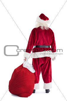 Santa is holding his bag in one hand
