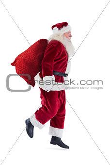 Santa jumps with his bag