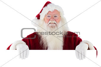 Santa looks over a sign