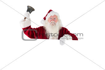 Santa holds a sign and rings his bell