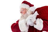 Santa carries his red bag