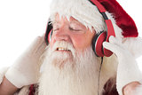 Santa Claus enjoys some music