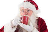 Santa drinks from a red cup