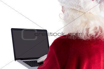Santa Claus uses a laptop