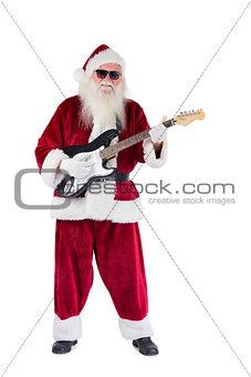 Santa Claus plays guitar with sunglasses