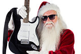Father Christmas shows a guitar