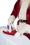 Father Christmas is ironing his hat