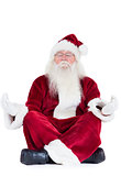 Santa Claus sits and meditates