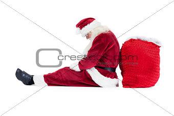 Santa sits leaned on his bag