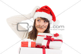 Santa woman scratching head and holding gifts