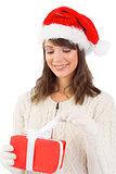 Festive brunette opening a gift