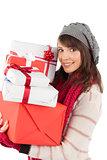 Festive brunette holding pile of gifts