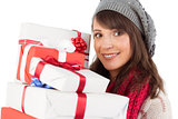 Portrait of a pretty woman holding pile of gifts