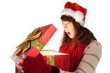 Shocked festive brunette opening a gift
